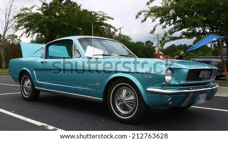 GLOUCESTER, VIRGINIA - AUGUST 23, 2014:A 1966 Ford Mustang in the DRIVE-IN FOR DIABETES CAR SHOW Sponsored by Tractor Supply in August in Gloucester Virginia. - stock photo