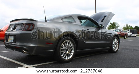GLOUCESTER, VIRGINIA - AUGUST 23, 2014:A grey Ford 5.0 Mustang in the DRIVE-IN FOR DIABETES CAR SHOW Sponsored by Tractor Supply in August in Gloucester Virginia. - stock photo