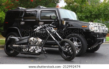 GLOUCESTER, VIRGINIA - AUGUST 23, 2014:A Hummer H2 and Motorcycle in the DRIVE-IN FOR DIABETES CAR SHOW Sponsored by Tractor Supply in August in Gloucester Virginia.