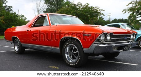 GLOUCESTER, VIRGINIA - AUGUST 23, 2014:A red 1969 Chevy El-Camino in the DRIVE-IN FOR DIABETES CAR SHOW Sponsored by Tractor Supply in August in Gloucester Virginia. - stock photo