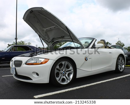 GLOUCESTER, VIRGINIA - AUGUST 23, 2014:A white BMW 3.0i convertible two door in the DRIVE-IN FOR DIABETES CAR SHOW Sponsored by Tractor Supply in August in Gloucester Virginia - stock photo