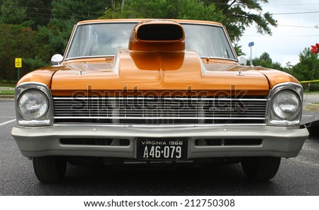 GLOUCESTER, VIRGINIA - AUGUST 23, 2014:An orange blown and tubbed 1966 Chevy II SS in the DRIVE-IN FOR DIABETES CAR SHOW Sponsored by Tractor Supply in August in Gloucester Virginia. - stock photo
