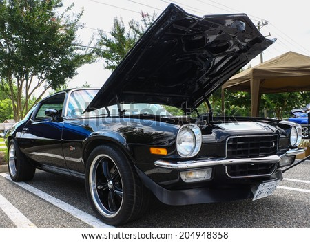 GLOUCESTER, VIRGINIA - JULY 12, 2014:A black 1973 Z/28 Chevy Camaro in the Blast from the PAST CAR SHOW,The Blast From the Past car show is held once each year in July in Gloucester Virginia. - stock photo