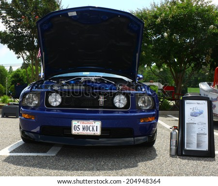 GLOUCESTER, VIRGINIA - JULY 12, 2014:A blue 2005 Mach one Mustang in the Blast from the PAST CAR SHOW,The Blast From the Past car show is held once each year in July in Gloucester Virginia. - stock photo