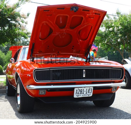 GLOUCESTER, VIRGINIA - JULY 12, 2014: A Red 1967 Chevrolet Camaro RS in the Blast from the PAST CAR SHOW,The Blast From the Past car show is held once each year in July in Gloucester Virginia.  - stock photo