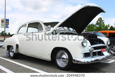 GLOUCESTER, VIRGINIA - JULY 12, 2014:A white 1947 Chevrolet in the Blast from the PAST CAR SHOW,The Blast From the Past car show is held once each year in July in Gloucester Virginia.  - stock photo