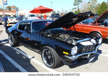 GLOUCESTER, VIRGINIA - NOVEMBER 14, 2015: A 1973 Chevy Camaro in the annual Shop With a Cop Car Show held once each year to help benefit needy children of Gloucester for Christmas.    - stock photo