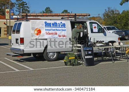 GLOUCESTER, VIRGINIA - NOVEMBER 14, 2015: The sheriffs fund raiser display in the annual Shop With a Cop Car Show held once each year to help benefit needy children of Gloucester for Christmas.