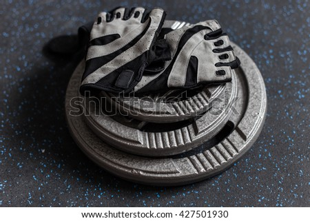Glove and plate weight, fitness equipment - stock photo