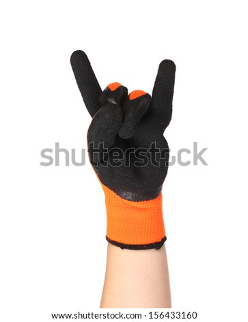 Gloved hand giving the Rock and Roll sign. Close up - stock photo