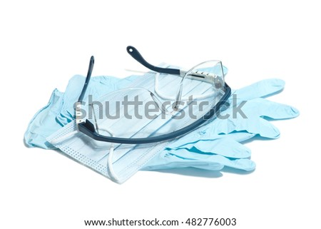 Gloves, mask, and safety glasses for use during medical procedures.