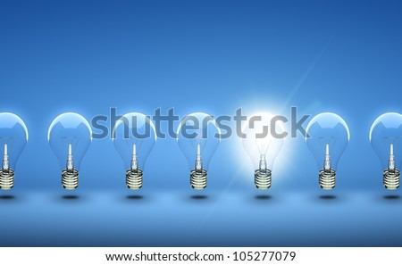 glow among other light bulb on a blue background