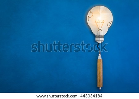glow bulb paper and wooden pencil on blue leather background creativity ideas concept - stock photo