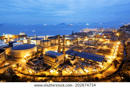 Glow light of petrochemical industry, Hong Kong - stock photo