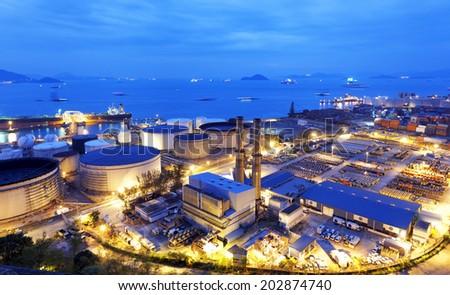 Glow light of petrochemical industry, Hong Kong - stock photo