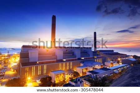 Glow light of petrochemical industry on sunset - stock photo