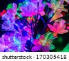 Glowing abstract multicolored flowers on a dark background - stock