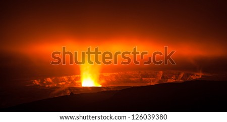 Glowing active volcano crater at night , Big Island, Hawaii - stock photo