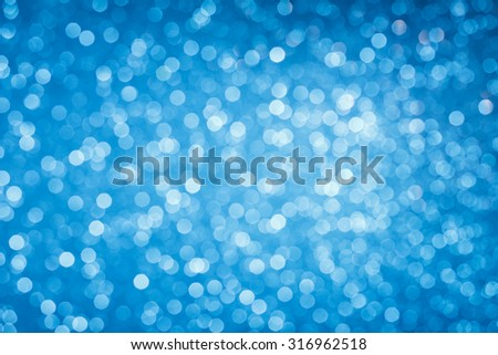 Glowing blue bokeh lights background - stock photo