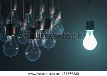 glowing bulb among the gray - stock photo