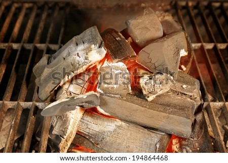 Glowing Charcoal in BBQ Pit - stock photo