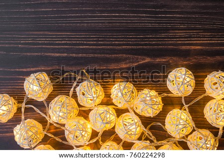 Glowing Christmas garlands round balls made of rattan
