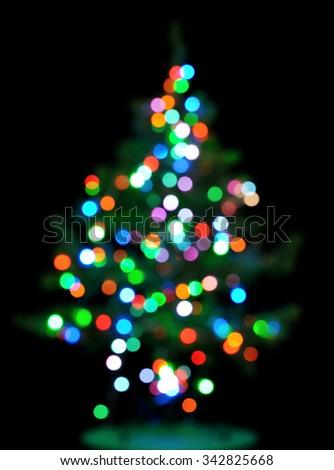 glowing christmas tree on black - stock photo