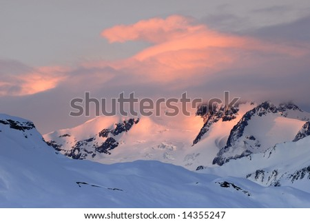 Glowing cloud above the mountains in Mont Blanc range