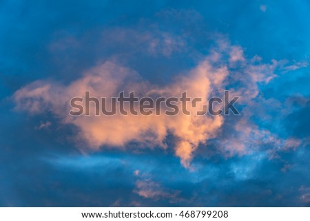 Glowing cloud in the dark evening sky