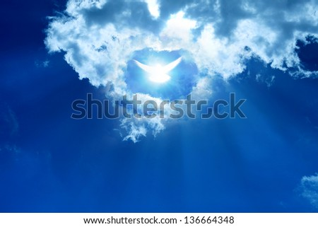 Glowing dove in a blue sky. Faith symbol. - stock photo