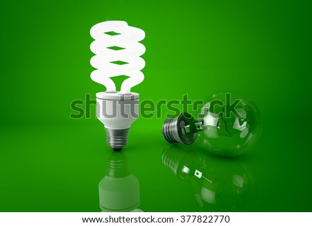 Glowing energy saving bulb and dark incandescent bulb over green background. Concept of saving energy. - stock photo