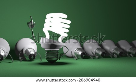 Glowing fluorescent light bulb character in moment of insight standing among many switched off lying tungsten ones on green textured background - stock photo