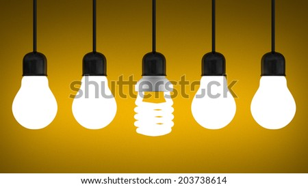 Glowing fluorescent light bulb hanging in row of tungsten ones on yellow textured background