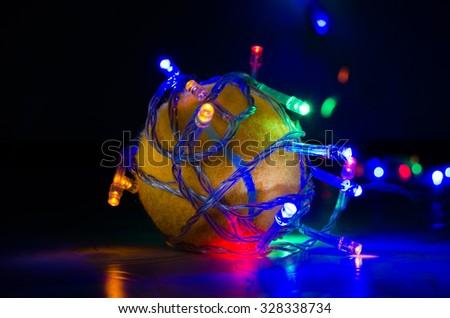 glowing garland around tennis ball - stock photo