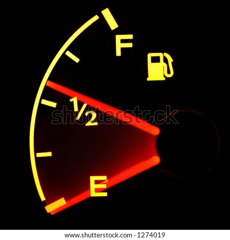 Glowing Gas Gauge Falling to Empty - stock photo