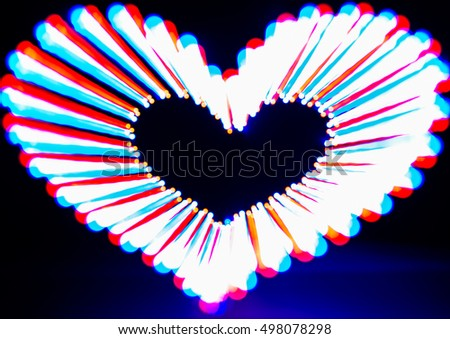Glowing heart on dark