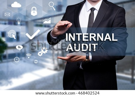 "Glowing icon ""Internal Audit"" in the hands of a businessman. Business concept. Internet concept."