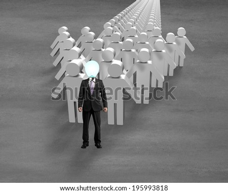 Glowing lamp head people in front of arrow on concrete ground - stock photo