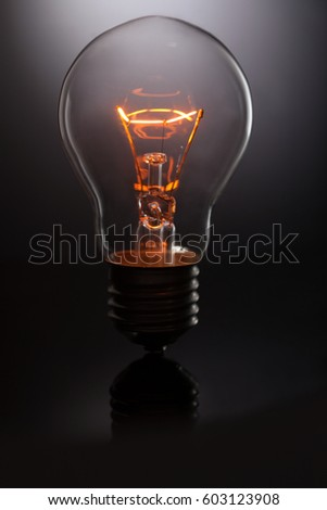 glowing lamp on black background