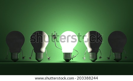 Glowing light bulb character in moment of insight among switched off ones on green textured background - stock photo