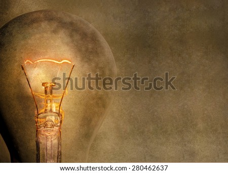 Glowing light bulb. Space for text.