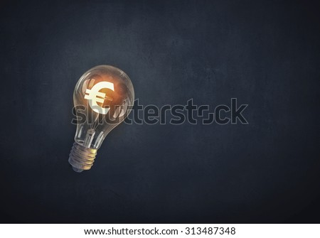 Glowing light bulb with euro symbol inside - stock photo