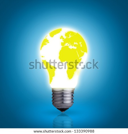 Glowing light bulb with world map on blue background