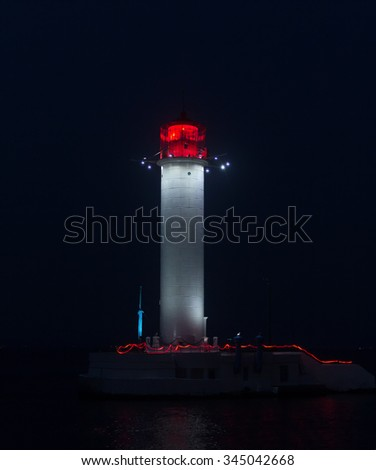 Glowing lighthouse at the entrance to the port. Odessa, Ukraine - stock photo