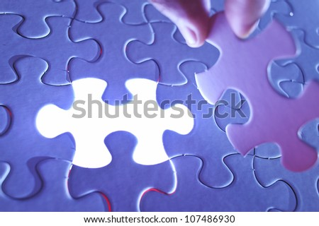 Glowing missing jigsaw puzzle piece, business concept for completing the final puzzle piece - stock photo