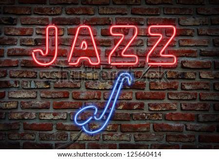 Glowing neon jazz sing on a brick wall. - stock photo