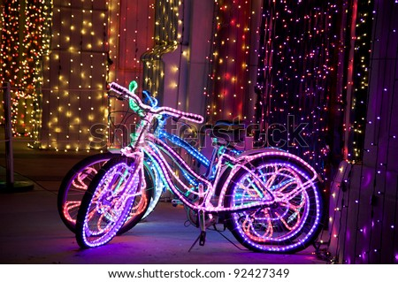Glowing psychedelic bikes with multicolored Christmas lights