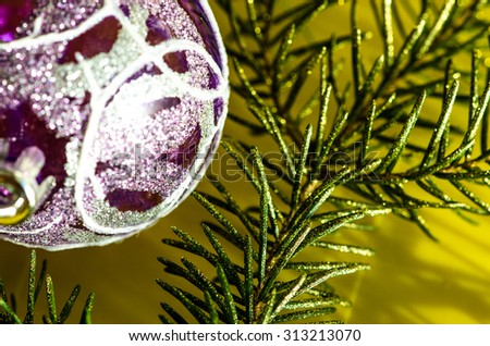 glowing purple christmas bauble decoration and pine branch