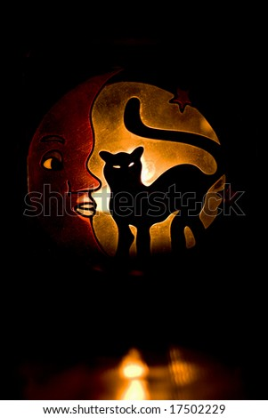 glowing silhouette of black cat in the dark. halloween background