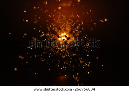 Glowing Sparks Abstract Background.